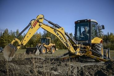 Image of backhoe moving dirt